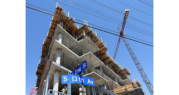 A crane towers over the 374-unit Legacy Condos project at 121 12th Ave. S. in the Mill District of Minneapolis. Jim Stanton is the developer. Legislation signed by Gov. Mark Dayton could lead to more condo and townhome development, the bill's advocates say. (Staff photo: Bill Klotz)