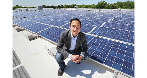 Gregg Mast, executive director of Clean Energy Economy Minnesota, is photographed with a solar array recently installed on the roof of the Veterans Memorial Community Center in Inver Grove Heights. (Staff photo: Bill Klotz)