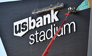 "The stadium's exterior showed a large, jagged swath just above the ""US Bank Stadium"" sign on the west prow. (Special to Finance and Commerce/John Autey)"