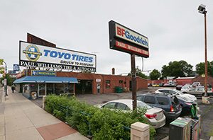 A building for an auto repair and tire business at 510 Lake St. W. in Minneapolis will be replaced with a six-story affordable apartment building if Lupe Development Partners wins approval.   (Staff photo: Bill Klotz)
