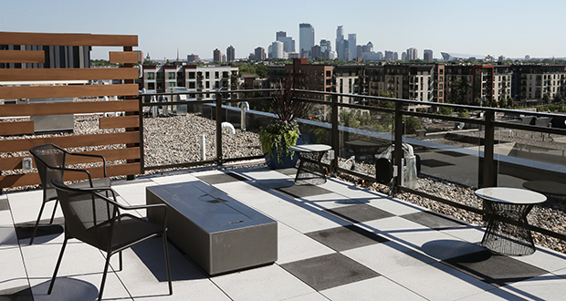 The Revel Apartments building has a rooftop patio with sweeping views of the city. (Staff photo: Bill Klotz)