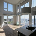 A two-bedroom loft apartment on Revel's top floor draws lots of sunlight.