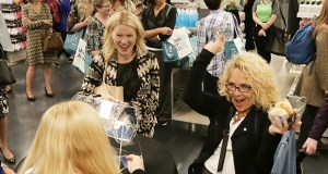 Wells Fargo employee Marcelle Gromek celebrates winning a Nordstrom Rack $100 gift card in a raffle Thursday as the new store opened in the IDS Center in downtown Minneapolis. (Staff photo: Bill Klotz)
