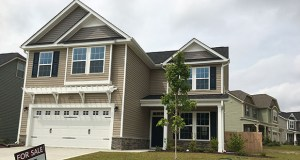 New home sales leapt 18.9 percent in September, the most in a decade, the Commerce Department said Wednesday. This Sept. 6 photo shows a new home for sale in Raeford, North Carolina. (AP Photo: Swayne B. Hall)