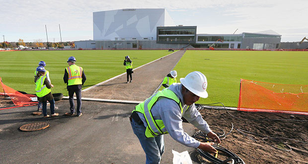 A worker installs tubing Monday for a lawn-irrigation system next to the four outdoor practice fields at the new Minnesota Vikings headquarters and practice campus in Eagan. (Staff photo: Bill Klotz)