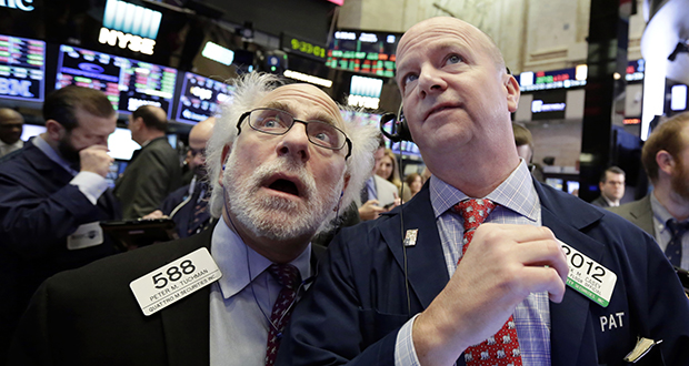 Traders Peter Tuchman, left, and Patrick Casey work on the floor of the New York Stock Exchange on Feb. 8. The stock market has found firmer footing following its breathtaking drop earlier this month, where the S&P 500 lost 10 percent in just nine days. (AP file photo)