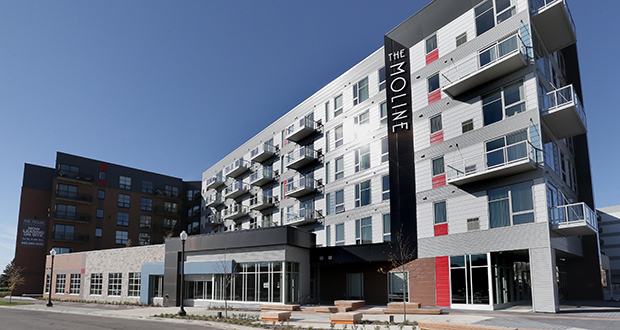Recently completed projects along the future Southwest Light Rail Transit line include this Moline Apartments complex at 100 Eighth Ave. S. in Hopkins. The $50 million project, developed by Doran Cos., is adjacent to the Downtown Hopkins station. (File photo: Bill Klotz)