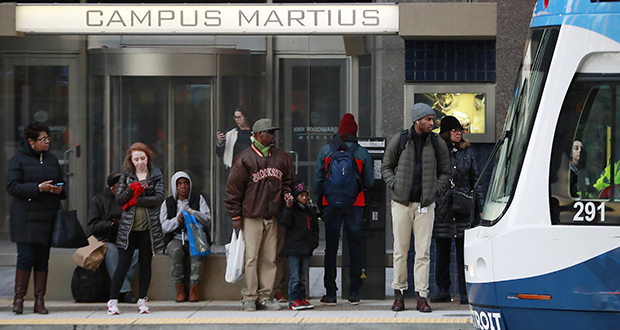Passengers wait on the QLINE transit train Jan. 26 in Detroit. Places such as Pittsburgh, Philadelphia and Detroit are touting their populations of people of color to chief executives and other corporate officials as part of being open for business. (AP Photo: Carlos Osorio)