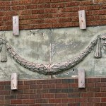 Sock and buskin, the two Greek symbols of comedy and tragedy, are displayed outside the Franklin Theater. The theater, at 1021 E. Franklin Ave., originally opened in 1916. (Staff photo: Bill Klotz)