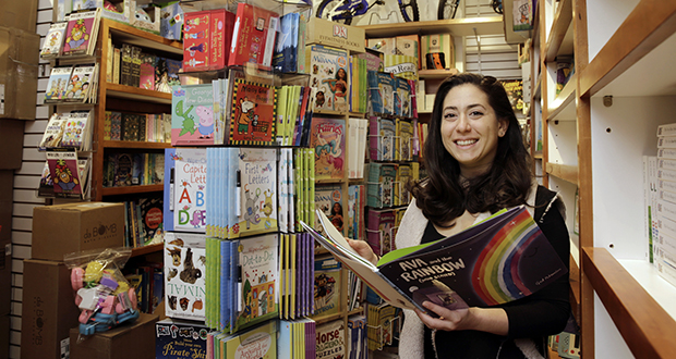 Judy Ishayik, owner of Mary Arnold Toys on Manhattan's Upper East Side, poses for a photo March 19 in the store's book department. Mary Arnold, a nearly 90-year-old store in Manhattan, is thriving along with many other small and independent toy stores, even as Toys R Us is going out of business and more consumers shop online. (AP Photo: Richard Drew)