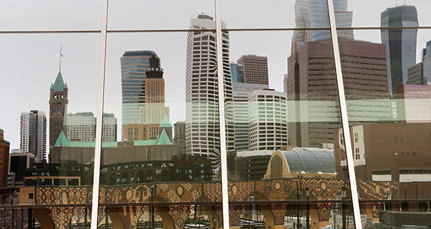 Downtown Minneapolis' skyline is reflected in U.S. Bank Stadium on Monday. During the 2016 fall migration season, 60 birds were killed and 14 were injured after colliding with the stadium's glass windows, according to a February 2017 study. (Staff photo: Bill Klotz)