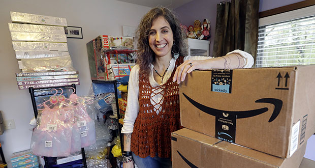 Adrienne Kosewicz, owner of Play It Safe World Toys, poses for a portrait April 6 in her home office in Seattle. Kosewicz pays $3,600 a year for tax collection software to handle payments and reports to her home state, Washington. Her Seattle-based online business sells through Amazon, which handles computation and collection. (AP Photo: Elaine Thompson)