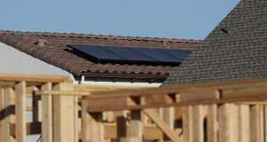 In this photo taken Monday, solar panels are shown on the rooftop of a home in a new housing project in Sacramento, California. (AP Photo: Rich Pedroncelli)