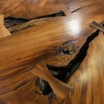 Detail shot of the  walnut table in the first-floor lobby.