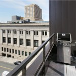 The sixth floor loft apartments come with a balcony with a view of the nearby Union Depot.
