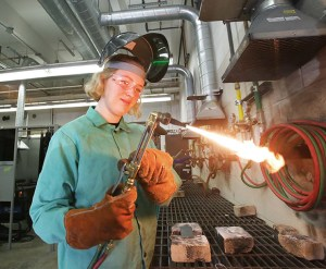 Roosevelt High School sophomore Alice Oman lights up an oxy acetylene cutting torch. (Staff photo: Bill Klotz)