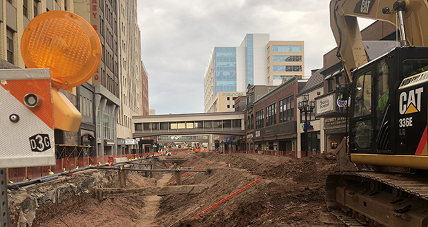 Workers from Northland Constructors are replacing utility lines under Superior Street in downtown Duluth, Minnesota, in the first phase of a $51 million reconstruction project slated to take three summers to complete.  (Submitted image: Northland Constructors)