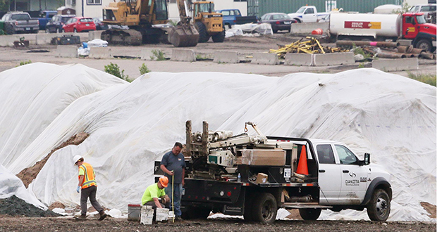 Workers continue to move earth Tuesday on the former site of Ford Motor Co.'s assembly plant in St. Paul's Highland Park neighborhood. Ford subsidiary Ford Land is cleaning up the property after razing the plant. The work is expected to be finished in 2019. (Staff photo: Bill Klotz)