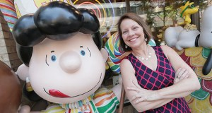 Finance & Commerce staff photographer Bill Klotz won a Page One award for best portrait photography for a portfolio including this photo of St. Paul Area Chamber of Commerce President and CEO B Kyle with a statue of Peanuts character Lucy. The photo was taken in front of the Candyland store in downtown St. Paul.