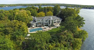 An aerial view is the only way to see the dramatic location of the 3-acre home site at 639 Bushaway Road in Wayzata, on a point between Wayzata Bay and Gray's Bay. (Submitted photo: Landmark Photography)