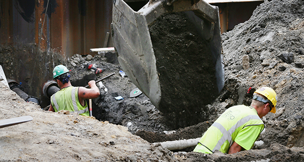 Workers on Thursday connected water and sewer pipes at 205 Park Ave. S. in Minneapolis, a six-story mixed-use apartment building under construction by Sherman Associates. Minnesota's construction industry gained 1,500 jobs in June, according to state data. (Staff photo: Bill Klotz)