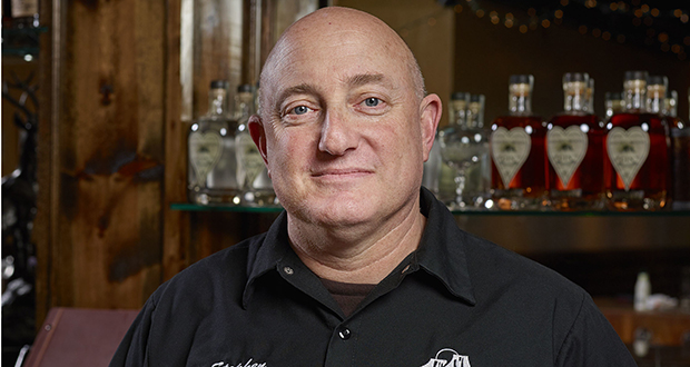 In this 2017 photo provided by Golden Moon Distillery, Steve Gould poses for a photo in Golden, Colorado. Before Europe retaliated against new U.S. tariffs with taxes of its own, Gould expected export revenue at his Golden Moon Distillery in Colorado to grow 15 percent to about 25 percent this year. (Photo: Sounders Studios/Golden Moon Distillery via AP)