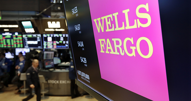 This May 17, 2018 photo shows the logo for Wells Fargo above a trading post on the floor of the New York Stock Exchange. (AP file photo)