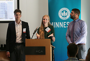 Eric Morin, left, Kaitlin Veenstra and Nate Day discuss Ryan Cos. US Inc.'s project examining the viability of erecting a net-zero office building. They spoke July 31 at a luncheon sponsored by the U.S. Green Building Council at the Minneapolis office of HGA. (Staff photo: Bill Klotz)