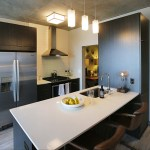 The kitchen of unit 1551, a one-bedroom and a den apartment.