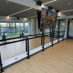 One of three fitness rooms, this one with a barre and mirrors.