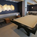 The game room has a billiard table along with a shuffleboard and other games.