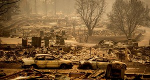 This Nov. 12 photo shows homes leveled by the Camp Fire on Edgewood Lane in Paradise, California.  Much of the town was destroyed by fire on Nov. 8. (AP Photo: Noah Berger)
