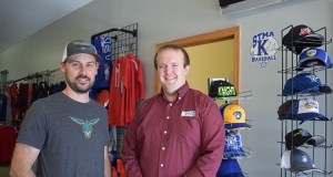 Travis Meyer (left), owner of LaZarre Graphics and Apparel in Albertville, Minnesota, worked with Corey Schiminski, an assistant vice president at Financial Security Bank, on getting Small Business Administration-backed loans from the bank. Financial Security Bank is among a dozen lenders the SBA's Minnesota District Office honored in 2018. (Submitted photo: SBA Minnesota District Office)