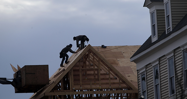 In this Feb. 26 photo, construction workers work on a new townhouse in Wood-Ridge, New Jersey. (AP file photo)