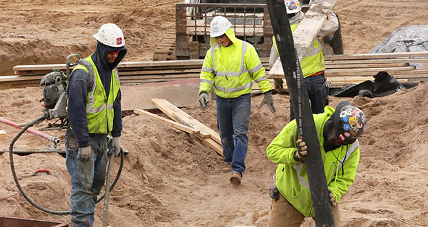 Year-to-date, Minnesota's construction industry has added 8,415 jobs, up 8.1 percent, according to the Minnesota Department of Employment and Economic Development. This April 10, 2018, photo shows concrete workers pouring footings for The CAPP, a mixed-use building developed by Oppidan in south Minneapolis. (File photo: Bill Klotz)