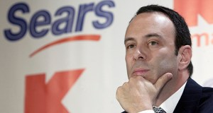 Sears Holdings Corp. is suing its former chairman and largest shareholder Eddie Lampert, alleging the billionaire stripped the once iconic company of more than $2 billion in assets. This November 2004 photo shows Lampert during a news conference to announce the merger of Kmart and Sears in New York. (AP file photo)