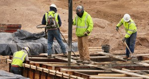 In response to a recent Associated General Contractors survey, 83 percent of respondents in Minnesota said they plan to increase their headcount in 2019. In this April 2018 photo, concrete workers pour footings for a mixed-use building being developed by Oppidan in south Minneapolis. (File photo: Bill Klotz)