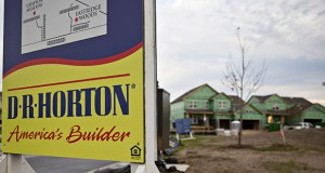 D.R. Horton spent more than $8 million buying property in the past two years from companies that are led by children of its chairman and its CEO. In this Oct. 19, 2018, photo, D.R. Horton signage stands in front of homes under construction at the Eastridge Woods development in Cottage Grove. (Bloomberg file photo)