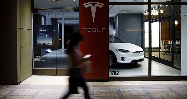 A pedestrian walks past a closed Tesla Inc. store March 7 in Palm Desert, California. California, the headquarters and biggest market for electric automaker Tesla Inc., had 273,656 electric cars registered at the end of last year. (Bloomberg file photo)