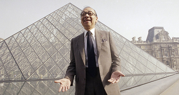 Chinese-American architect I.M. Pei laughs while posing for a portrait March 29, 1989, in front of the Louvre glass pyramid, which he designed, in the museum's Napoleon Courtyard, prior to its inauguration in Paris. (AP file photo)