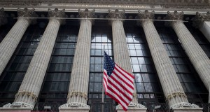 The SEC recently passed new regulations it says will help protect Americans seeking help investing their money. In this Nov. 20, 2018, photo, an American flag flies outside New York Stock Exchange. (AP file photo)