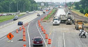 Rogers-based New Look Contracting submitted a $15 million apparent low bid Friday for a temporary crossover on I-94, a prelude to the I-94 expansion between Maple Grove and Clearwater. In this 2015 photo, crews work on a segment of I-94 near Rogers. (Submitted photo: MnDOT)