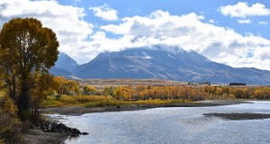 In this Oct. 8, 2018 file photo, emigrant Peak is seen rising above the Paradise Valley and the Yellowstone River near Emigrant, Mont. (AP Photo/Matthew Brown)