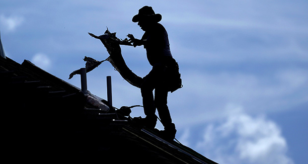 The Labor Department reported Wednesday that pay and benefits for all U.S. workers increased 2.7% in the April-June quarter from a year earlier. In this July 18 photo, a roofer works on a new home under construction in Houston. (AP file photo)