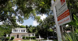 This July 22 photo shows a home for sale in Miami. Prices increased 3.3% in Miami, according to the Standard & Poor's/Case-Shiller 20-city home price index released Tuesday. (AP file photo)