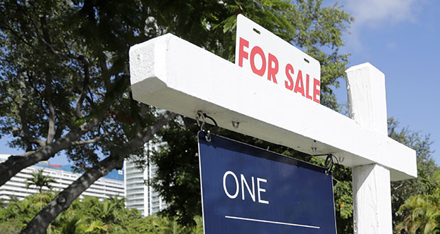 The National Association of Realtors said Tuesday that home sales fell 2.2% over the past 12 months. This July 19 photo shows a home for sale in Miami. (AP Photo: Lynne Sladky)