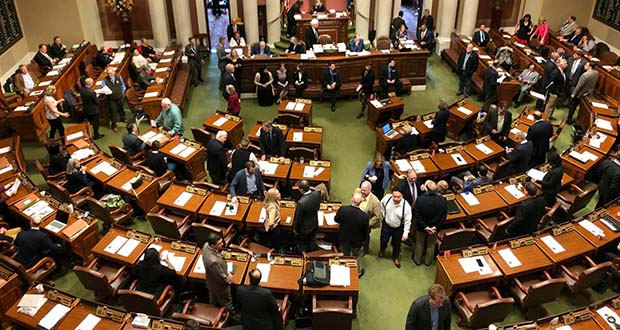 Representatives gather on the floor of the Minnesota House on the opening day of a special session on Friday, May 24, in St. Paul. Launch Minnesota's relatively modest investment drew low-key support from both sides of the aisle. (AP file photo)