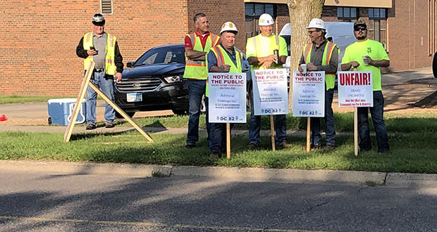 Union representatives picket outside the Wayzata Central Middle School at 305 Vicksburg Lane in Plymouth. (Submitted photo: Local 563)