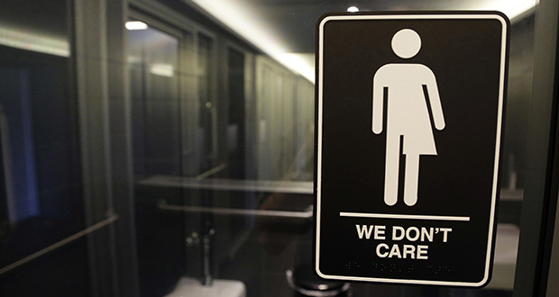 Signage hangs outside a restroom at 21c Museum Hotel in Durham, N.C., in this 2016 file photo. (AP file photo)
