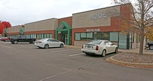 The new owner of the four buildings in the Parkway Place office-warehouse complex at 4205-4255 White Bear Parkway in Vadnais Heights are planning to update the exteriors, interiors and landscaping to draw new tenants. (Submitted photo: CoStar)